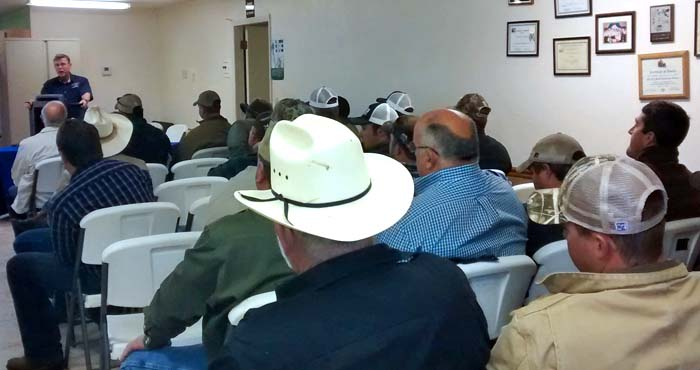 people sitting in on pesticide training
