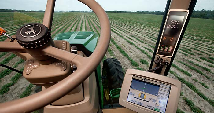 tractor showing computer equipment for row crops