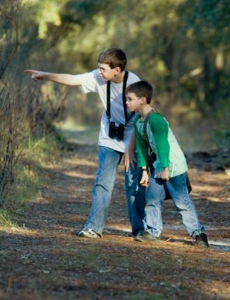 Explore Your World backpack program -- children on nature walk